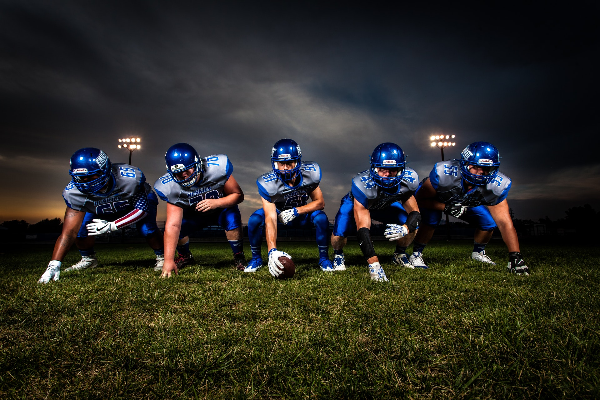 football-players-in-blue-jersey-lined-under-grey-white-186076