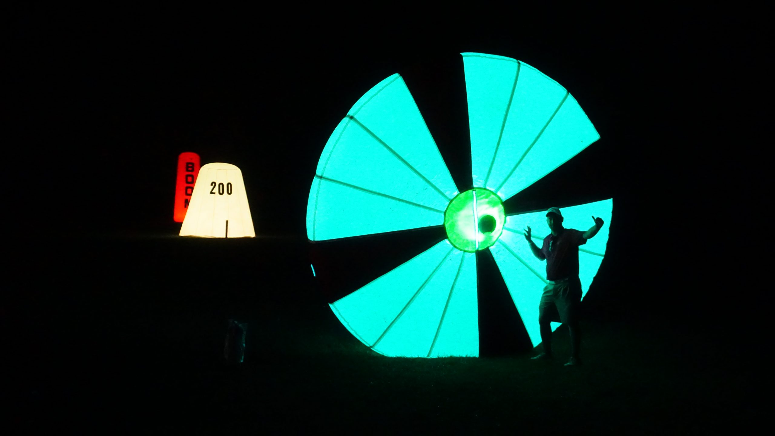 Inflatable flop shot wall at night